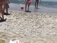 Young guys and girls are having fun at the beach