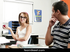 Chick in glasses is tasting classmate's dick