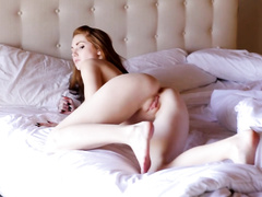 Sweetie redhead babe gets nude on the bed and enjoys pussy masturbation