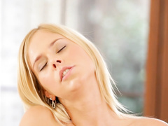 Charming hot blonde babe is passionately masturbating cunt