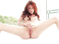 Redhead chick is pleasuring hot masturbation with dildo toy