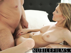 Handsome dude is tightly squeezing blonde's breasts and making her to suck his dick