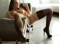 Long haired brunette demonstrates amazing poses in hot stockings
